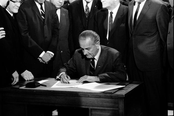 LBJ_signing_Civil_Rights_Act_of_1968_ppmsca.03196.jpg